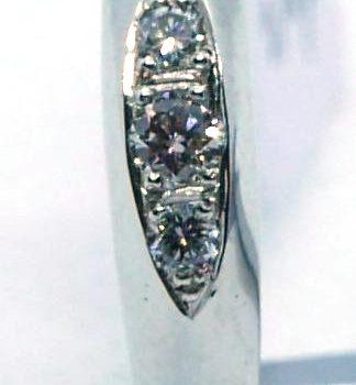 Prsten z bílého zlata s brilianty